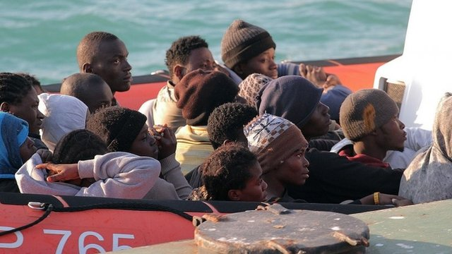Migrants on a coast guard dinghy boat arrive at the Sicilian Porto Empedocle harbour
