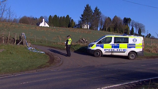 Police search a farm