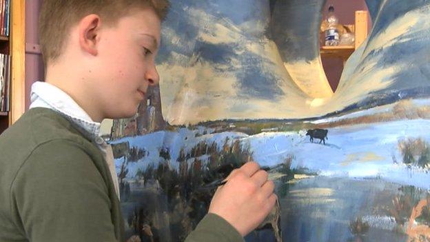 Kieron painting the sculpture