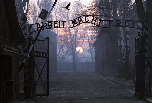 "This file picture taken in 12 January 2005 depicts Auschwitz I concentration camp gate, with the inscription ""Arbeit Macht Frei"""