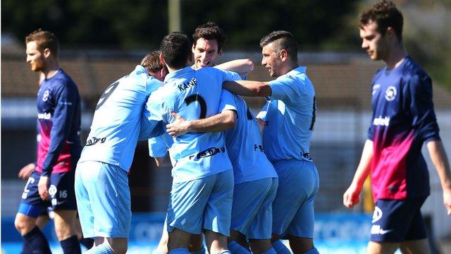 Ballymena players celebrate victory over Ballinamallard