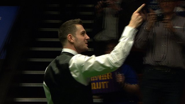 Defending world champion Mark Selby celebrates victory