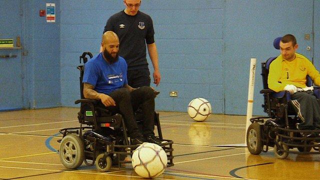 Tim Howard plays wheelchair football