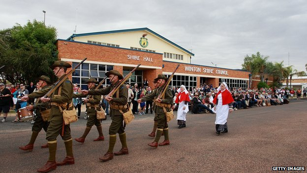 "Members of the ""9th Battalion AIF Living History Unit"" march in Winton, Australia."
