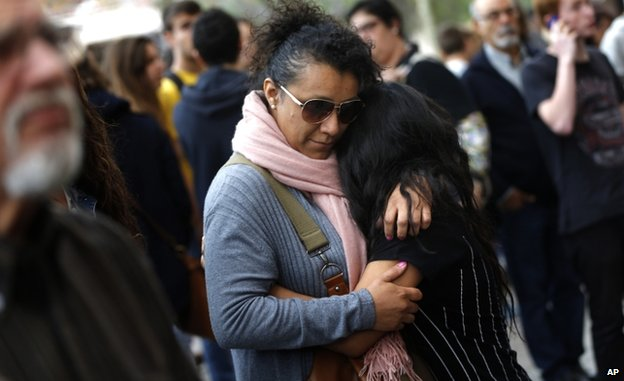 A pupil is hugged outside Joan Fuster institute (20 April)