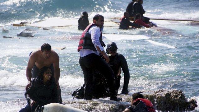 Greek coastguard and locals help to rescue migrants