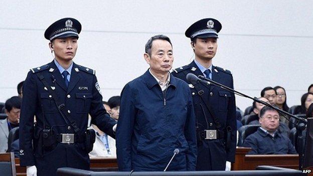 "Former chairman of China National Petroleum Corp (CNPC) Jiang Jiemin (C) standing on trial in a courtroom in Hanjiang Intermediate People""s Court in Xiantao"