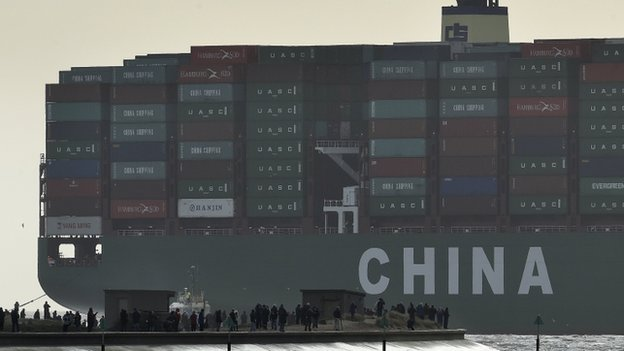 Onlookers watch from a harbour wall as the largest container ship in world, CSCL Globe, docks during its maiden voyage, at the port of Felixstowe in south east England