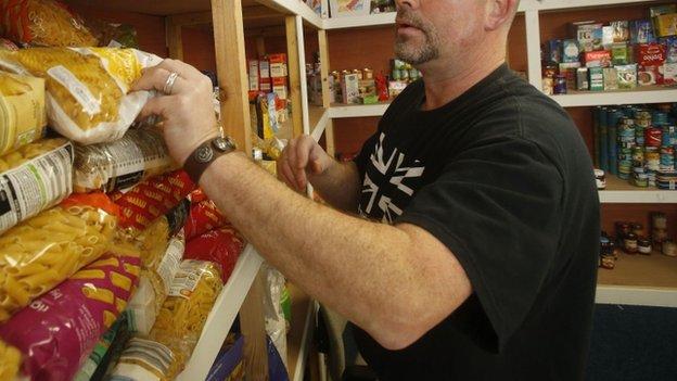 A volunteer at a food bank