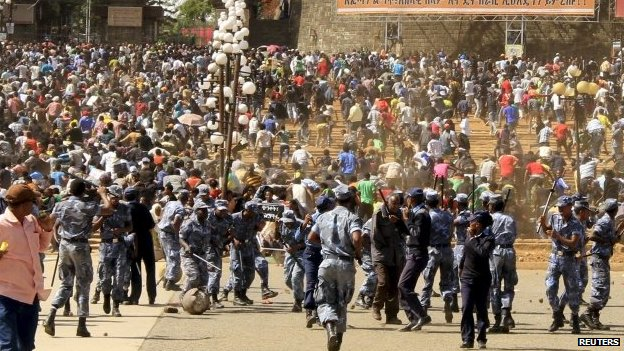 People scamper from police in Addis Ababa, Ethiopia, after a mass rally condemning the IS killings - 22 April 2015