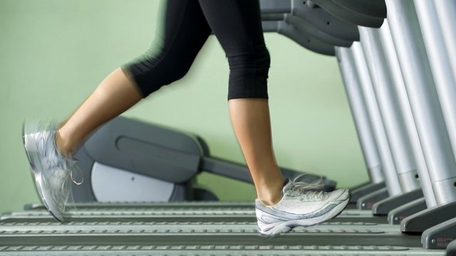 Woman running on treadmill in gym