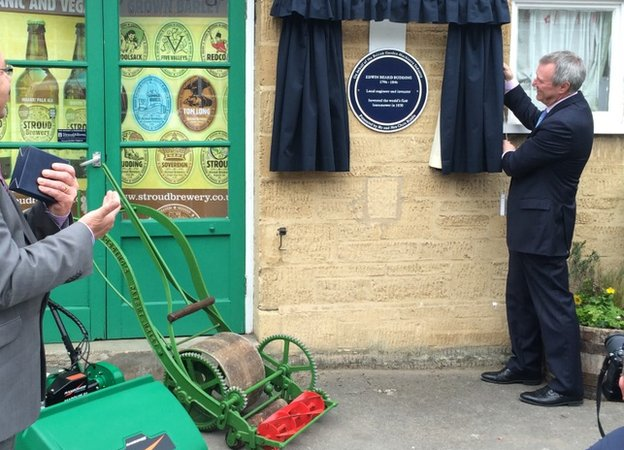 Blue plaque being unveiled