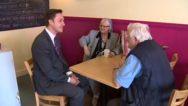 Paul Heaney with voters in a cafe in Merthyr Tydfil