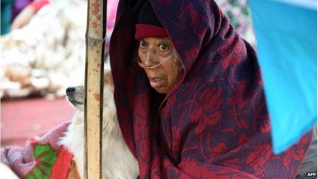 Patient Sanu Ranjitkar at a makeshift outdoor shelter in Kathmandu, Nepal (27 April 2015)