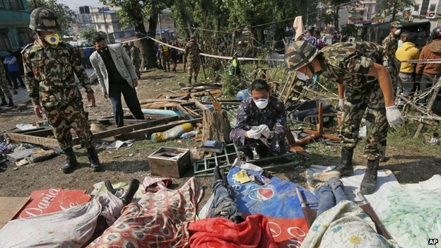Rescuers identify bodies from the collapsed Sitapyla church in Kathmandu, Nepal, after the earthquake, 27 April 2015