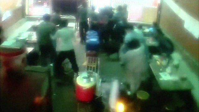 People rush for exit of Chinese restaurant in Nepal