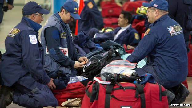 Rescue workers checking bags