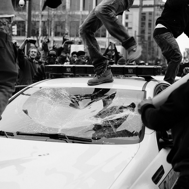 """Several photojournalists in Baltimore have been arrested by police or assaulted by protesters. Allen says: 'My mother called me, and said """"Boy, why are you on the front lines like that?"""" I had to calm her down and tell her I'm okay. I know what I'm doing. I know that if I get the right shot at the right time, I can show people things they don't see on the news.'"""