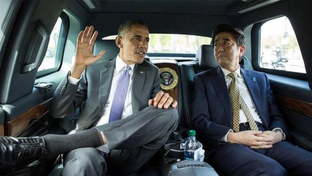 U.S. President Barack Obama (L) and Japanese Prime Minister Shinzo Abe ride together en route to the Lincoln Memorial in Washington in this 27 April 2015 handout photo