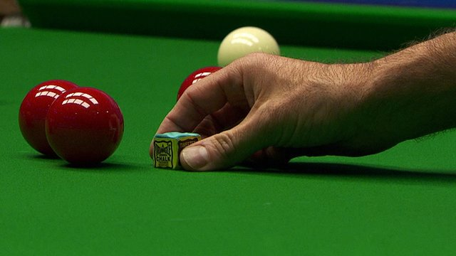 Ronnie O'Sullivan places the chalk on the table at the World Snooker Championship
