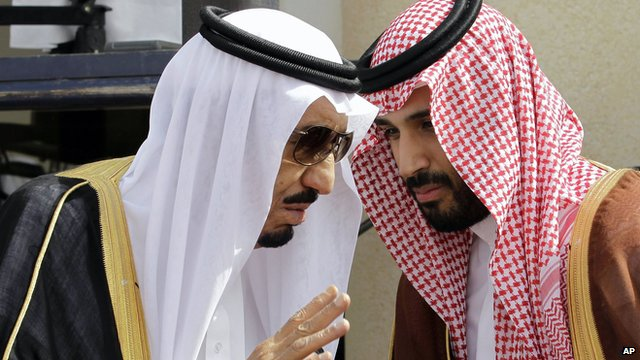 In this May 14, 2012 file photo, then Crown Prince Salman bin Abdul-Aziz Al Saud, left, speaks with his son Prince Mohammed as they wait for Gulf Arab leaders ahead of the opening of Gulf Cooperation Council, also known as GCC summit, in Riyadh, Saudi Arabia