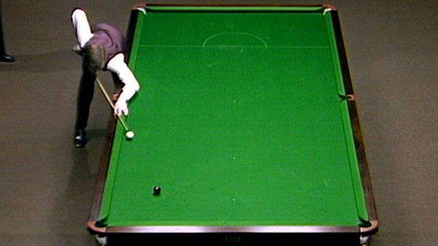 Steve Davis attempts to pot the black ball to win the 1985 World Snooker Championship