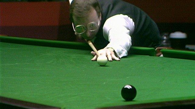Dennis Taylor pots the deciding black ball of the 1985 World Snooker Championship
