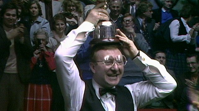 Dennis Taylor lifts the World Snooker Championship trophy