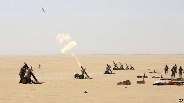 Saudi soldiers fire artillery towards the border with Yemen in Najran, Saudi Arabia