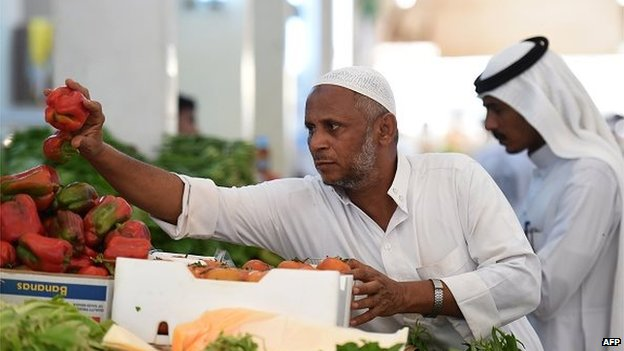 A Saudi vendor displays his products on a stall at a market