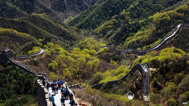 Chinese tourists climb the Great Wall at Badaling, north of Beijing, on April 22, 2015