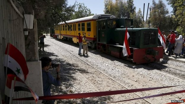 People attend the relaunch of the train service in Damascus. Photo: 1 May 2015
