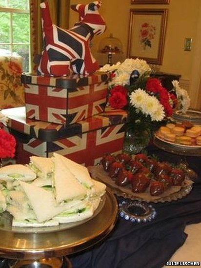 Cucumber sandwiches, strawberries, scones and Union Flag decorations laid out by Julie Lischer