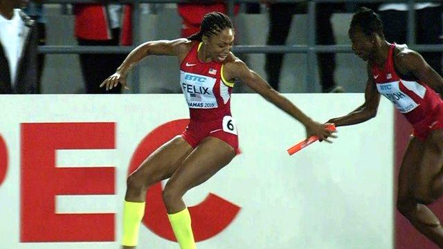 USA's Jeneba Tarmoh tries to hand the baton to Allyson Felix