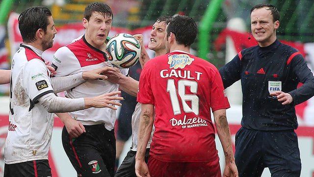 Portadown's Michael Gault appeared to be hauled down by Glentoran's Willie Garrett in the big talking-point of Saturday's Irish Cup final