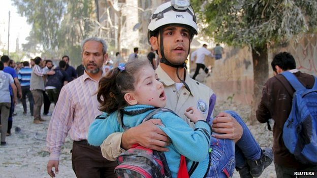 Child rescued from alleged barrel bomb attack in Aleppo. 3 May 2015