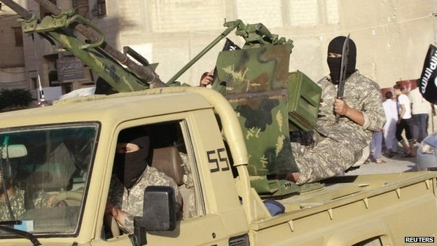 Heavily-armed Islamic State fighters drive through Raqqa, Syria (30 June 2014)