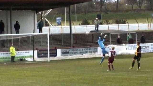 Berwick Rangers keeper Michael Andrews is beaten by a halfway line shot by Arbroath defender Ricky Little
