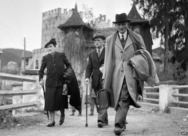 Gen Weygand (right) and wife leaving Schloss Itter, May 1945