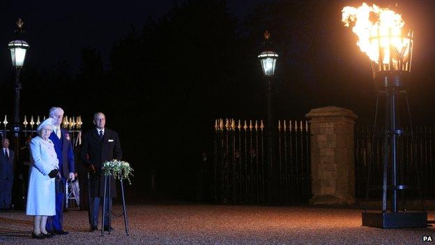 The Queen lighting beacon