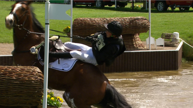 German rider Niklas Bschorer accidentally sets off his protective airbag will battling to stay on his horse at the Badminton Horse Trials