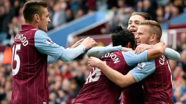 Aston Villa players celebrate Tom Cleverley's goal against West Ham United