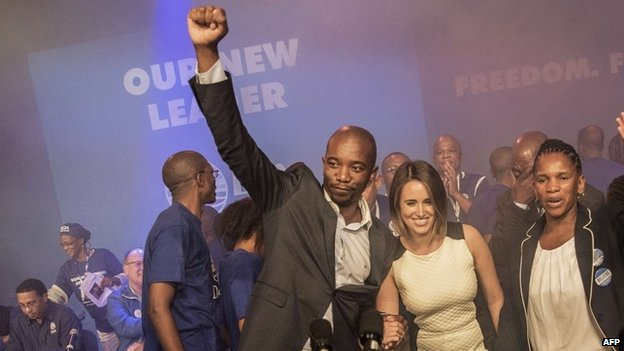 South Africa main opposition party Democratic Alliance newly elected Leader Musi Maimane (L) raises his fist as he celebrates his victory, on May 10, 2015 in Port Elizabeth, South Africa