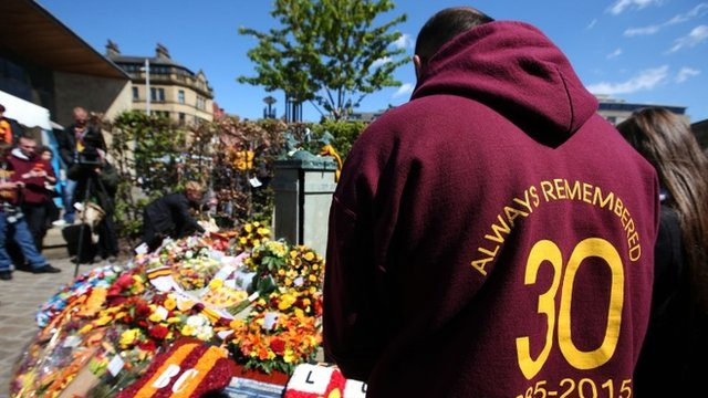 People attend service for the anniversary of Bradford City fire disaster