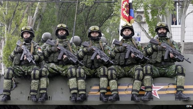 Pro-Russian rebels ride an armoured personal carrier (APC) during the military parade in downtown Donetsk, Ukraine, 9 May 2015
