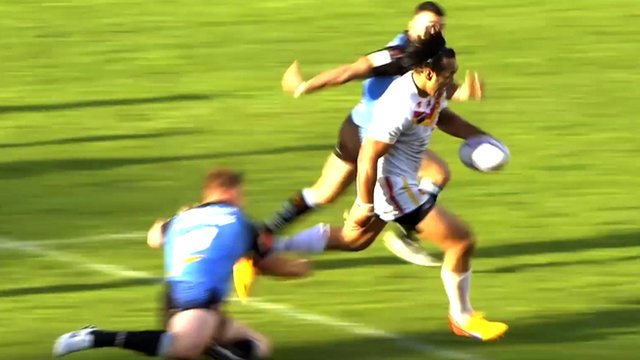 Zeb Taia scores a try for Catalans Dragons against St Helens