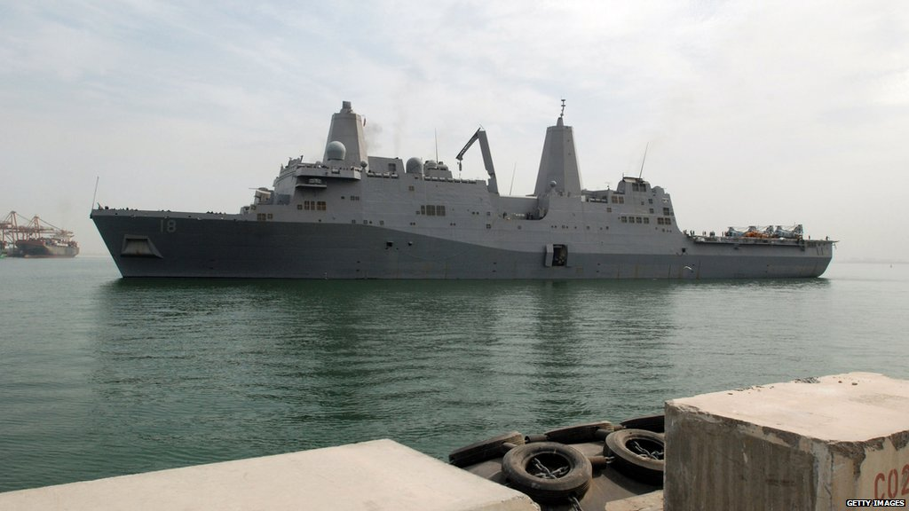 In a photo from March 2009, the USS New Orleans arrives at Mina Salman pier