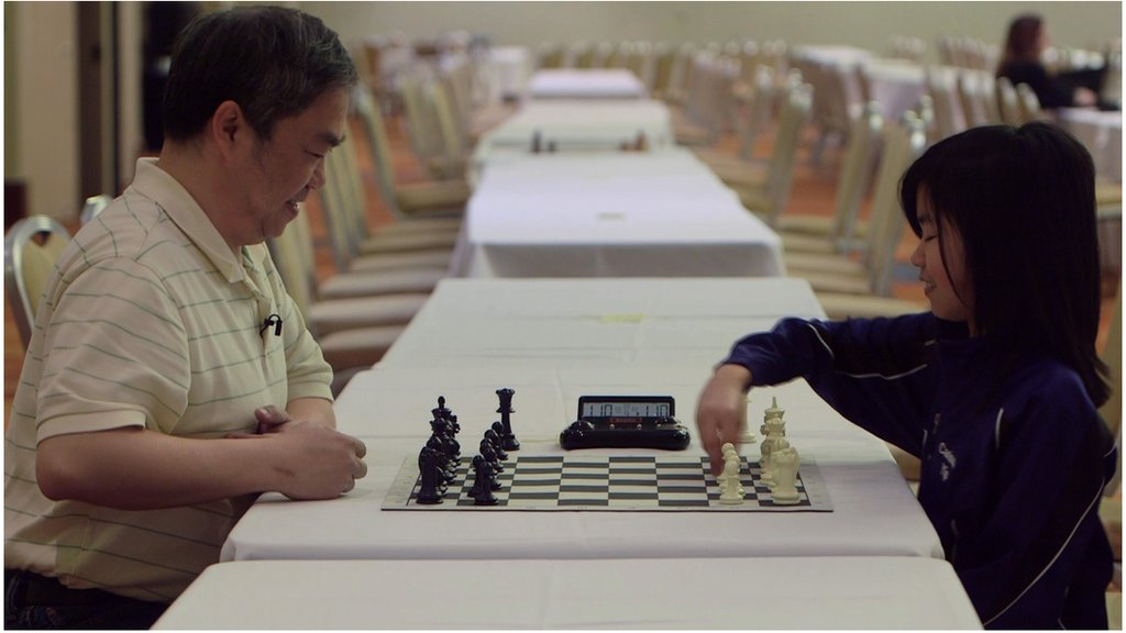 Carissa Yip and her dad play chess