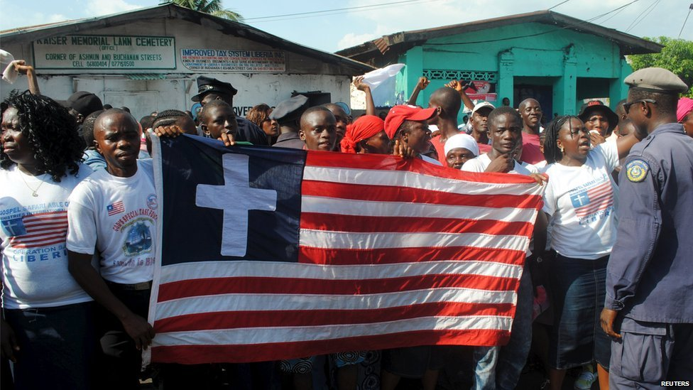 People carry the Liberian flag