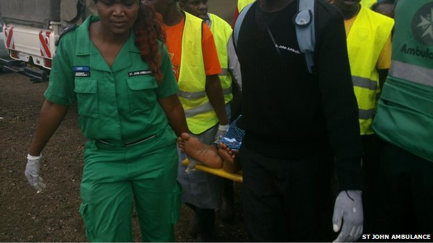 St Johns Ambulance carry away an injured person